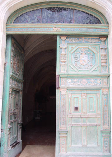 Carved wooden door to the castle