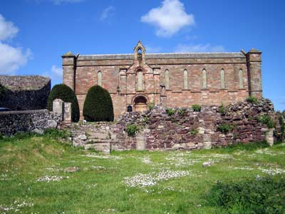 South facade of the 19th century parish church among the ruins of Coldingham Priory