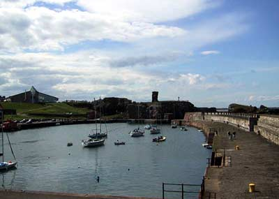 Dunbar's picturesque fishing harbour with the castle at one end