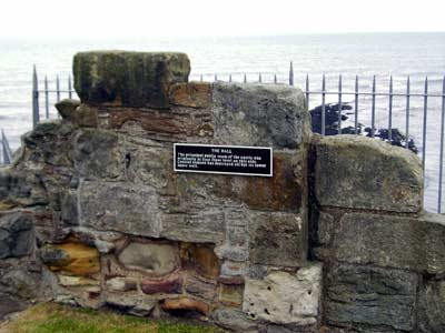 Remains of the Hall, the principal public room of the castle, destroyed by coastal erosion